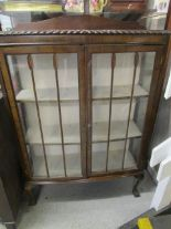 Lot 38 - An early 20th century walnut display cabinet on cabriole legs and ball and claw feet, along with a