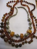 Lot 51 - Two amber necklaces and a white metal necklace with three amber disc beads