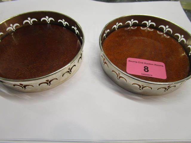 Lot 8 - A pair of silver wine coasters, A/F, a tea strainer and a letter knife, A/F, Birmingham