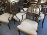Lot 42 - Six 1920s mahogany slat back carver dining chairs on tapered, fluted legs
