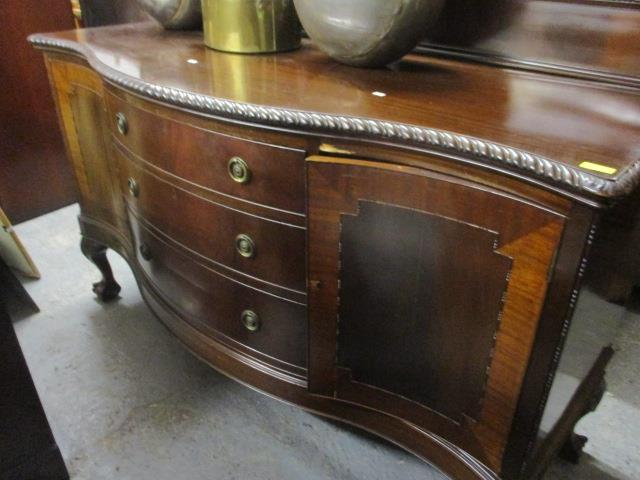 Lot 41 - A 1920s matched suite comprising a serpentine fronted sideboard with three central graduated drawers