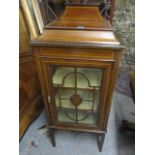Lot 394 - An Edwardian inlaid mahogany display cabinet with a glazed door and a shelved interior, A/F