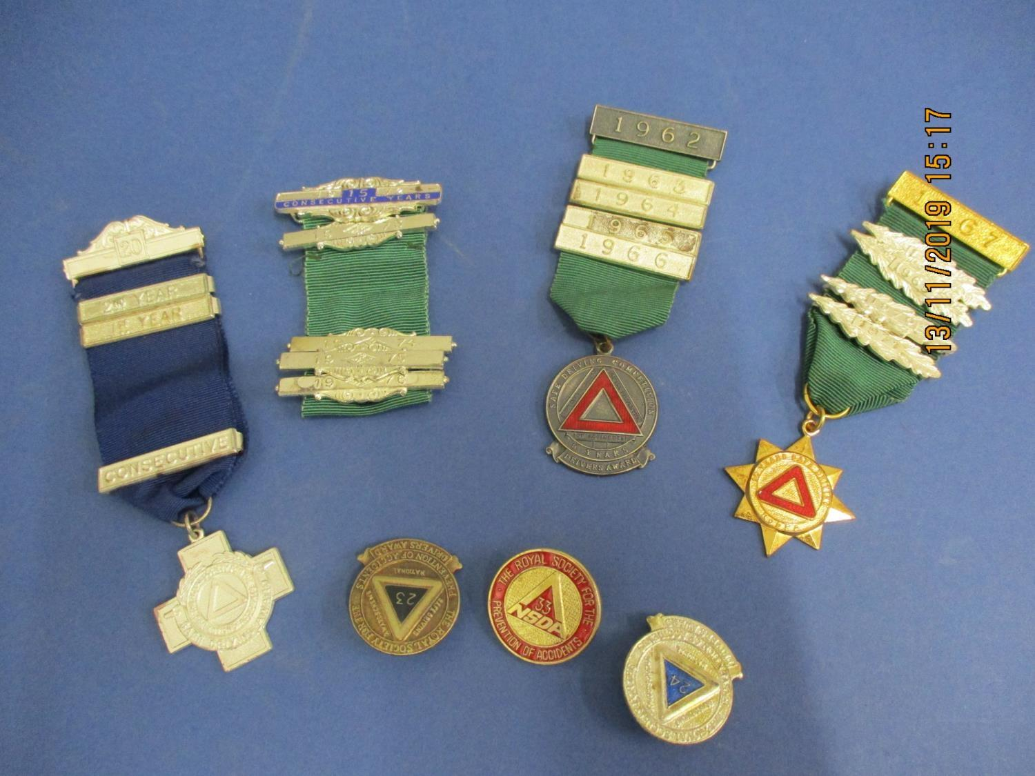 Lot 60 - A small quantity of driving badges and medals with ribbons, circa 1960