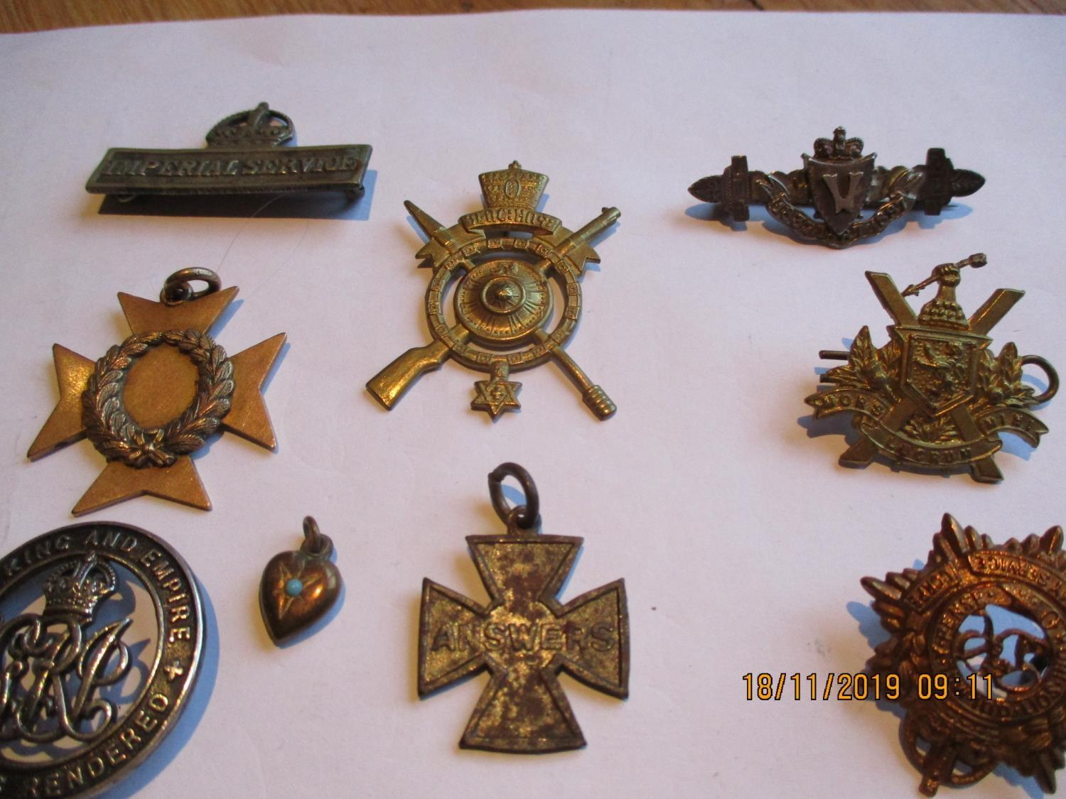 Lot 357 - A campaign medal awarded to Captain F Jeeves, an Imperial Service badge and other badges to