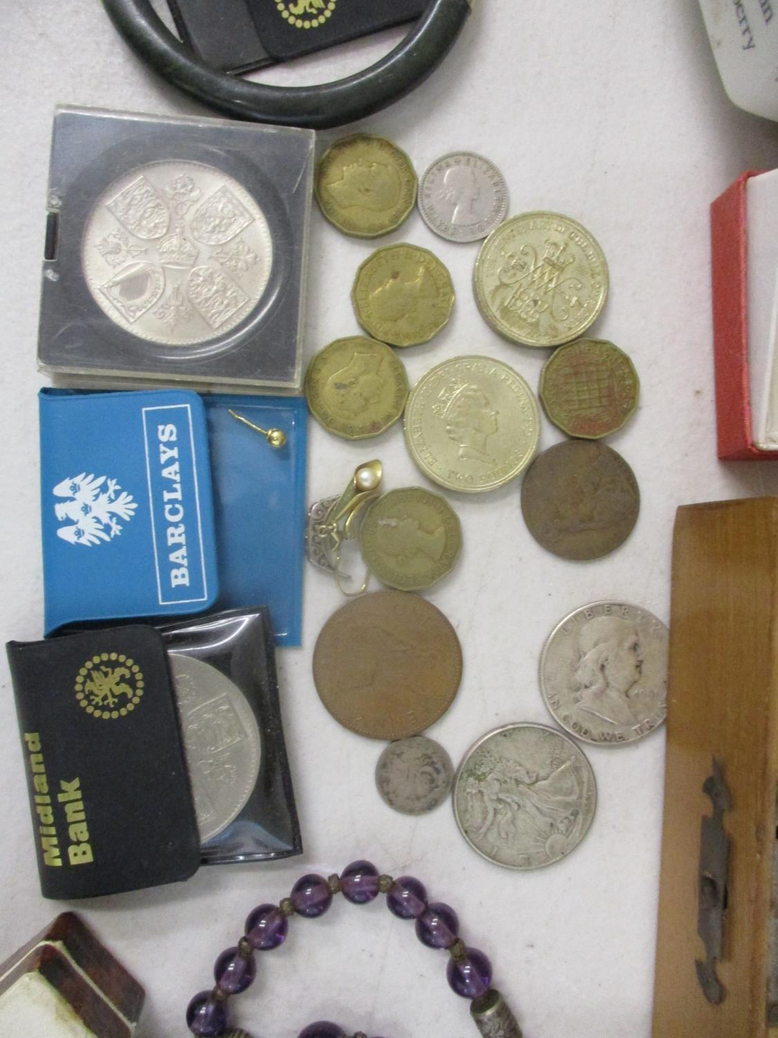 Lot 135 - Collectables to include a silver cased wristwatch, coins, a ten shilling banknote, an enamelled