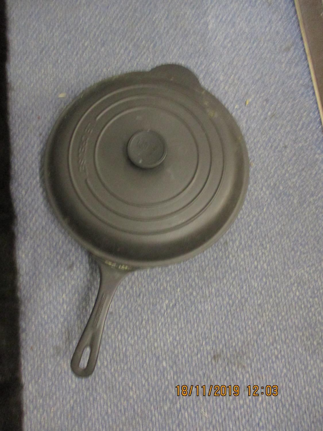Lot 386 - Le Creuset - two red frying pans and one casserole dish, together with a black Le Creuset frying pan