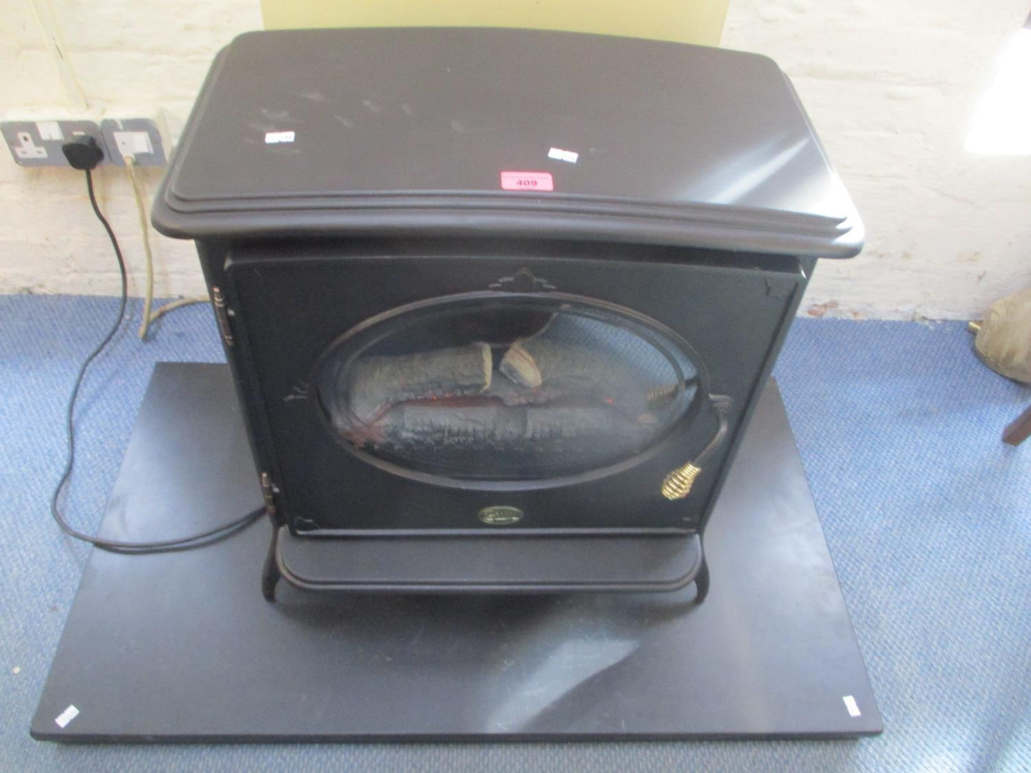 "Lot 409 - A black electric stove effect heater, 23"" h x 22""w"