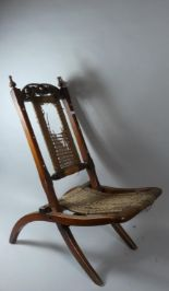 Lot 58 - A Late Victorian Mahogany Folding Chair with Carved and Pierced Top Rail and Caned Seat and Back