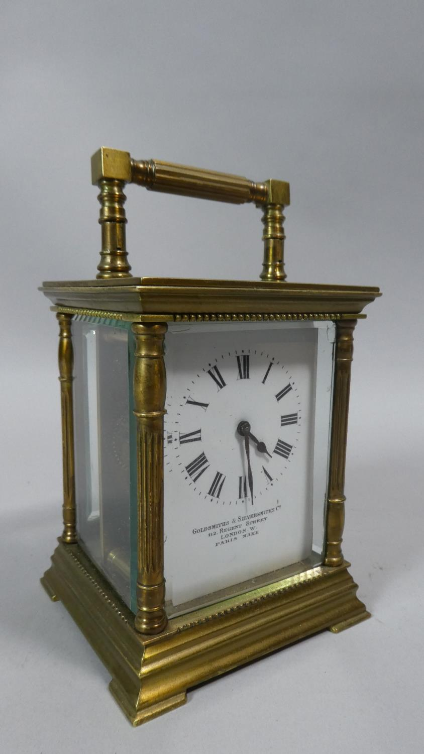 Lot 2 - A Brass Carriage Clock with White Enamelled Dial Inscribed Goldsmiths & Silversmiths Co. Regent
