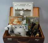 Lot 127 - A Vintage Cased Containing Canadian Number Plate, Spaniel Ornament, Books, Poster Etc