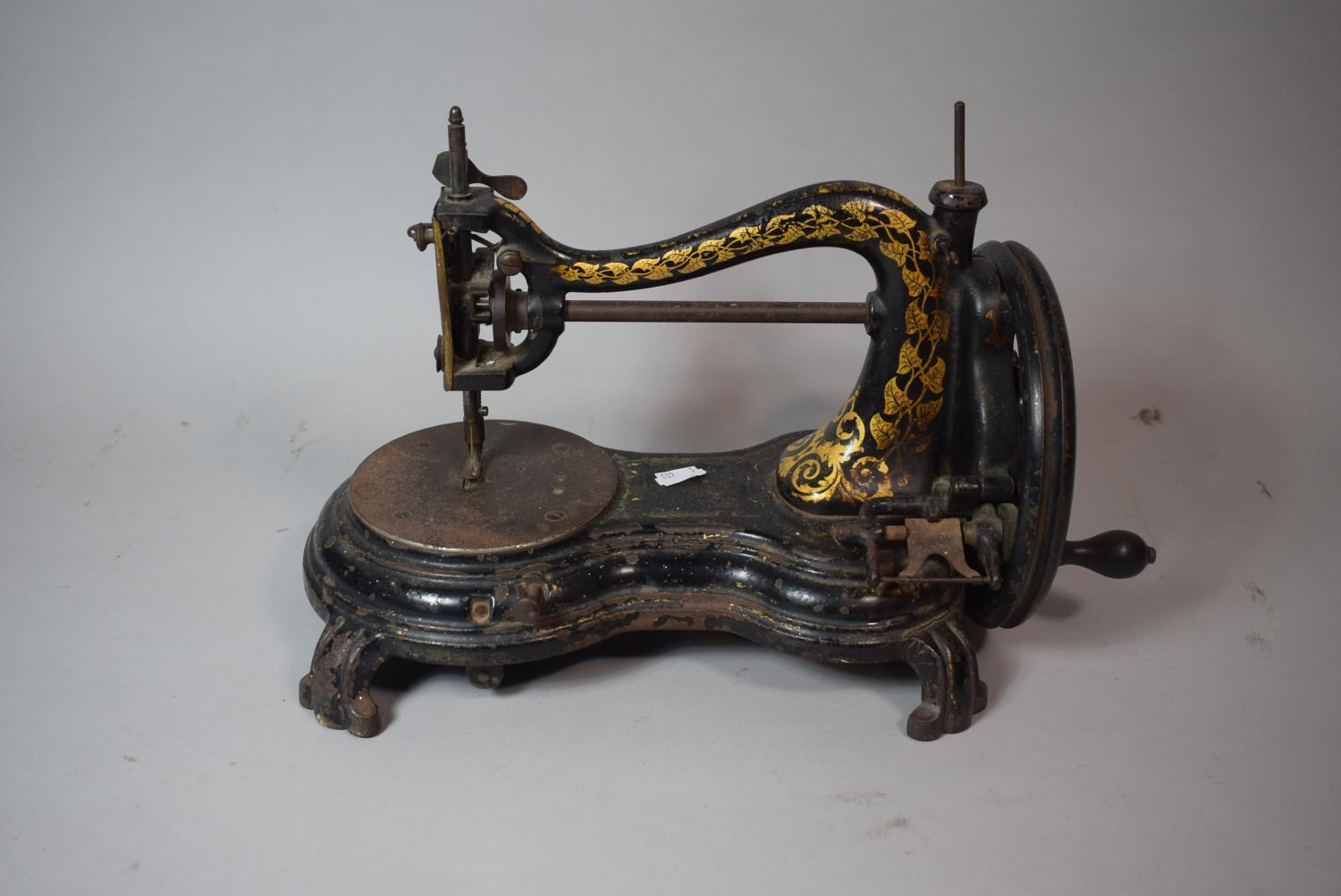 Lot 76 - A Vintage Gilt Decorated Sewing Machine