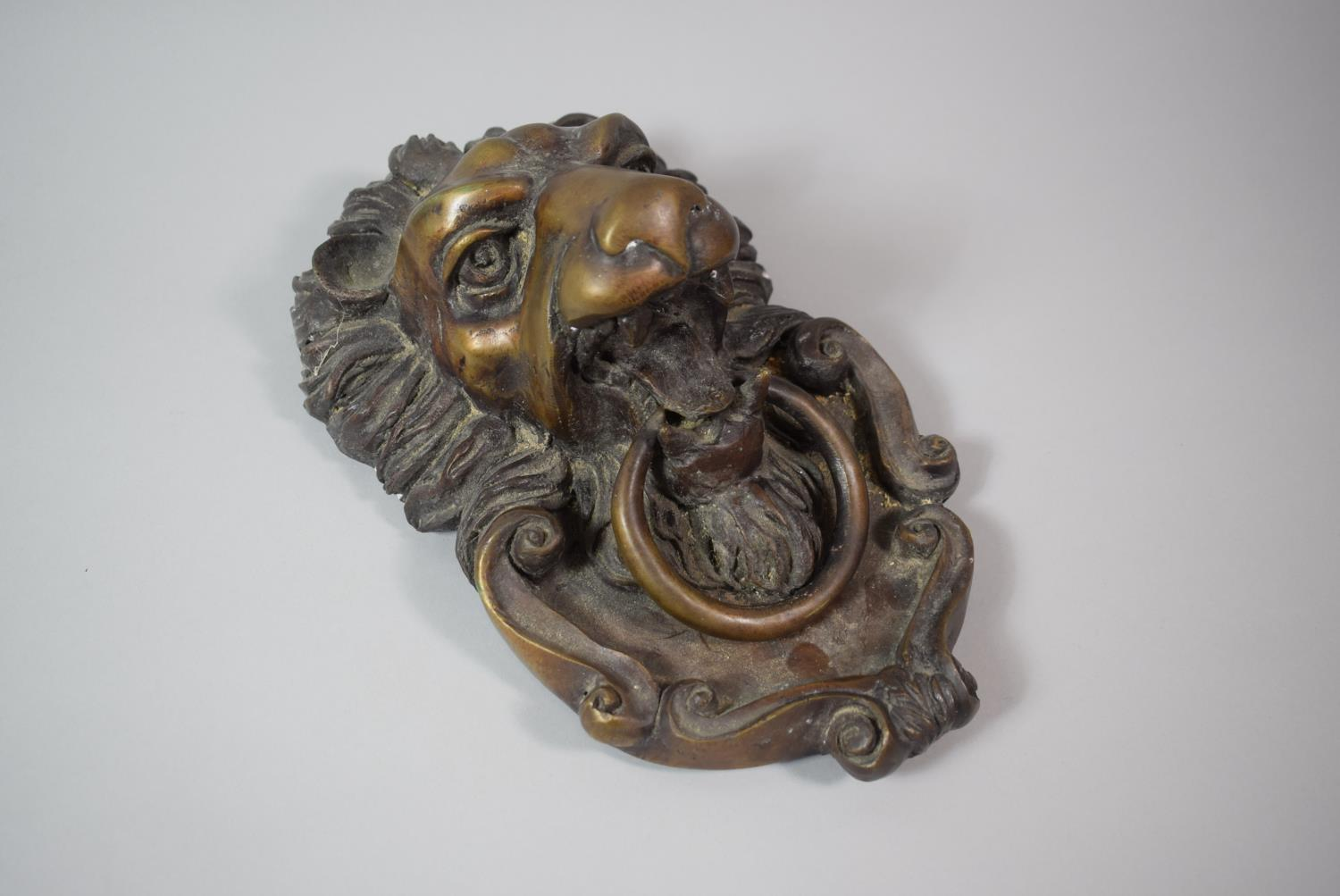 Lot 40 - A Large Heavy Cast Bronze Door Knocker in the Form of a Lion Mask, 29cm High