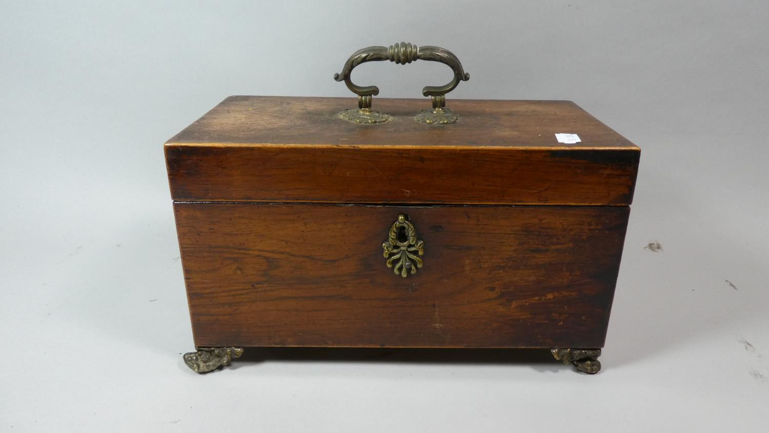 Lot 17 - A 19th Century Two Division Rosewood Tea Caddy with Ormolu Claw Feet, Carrying Handle and