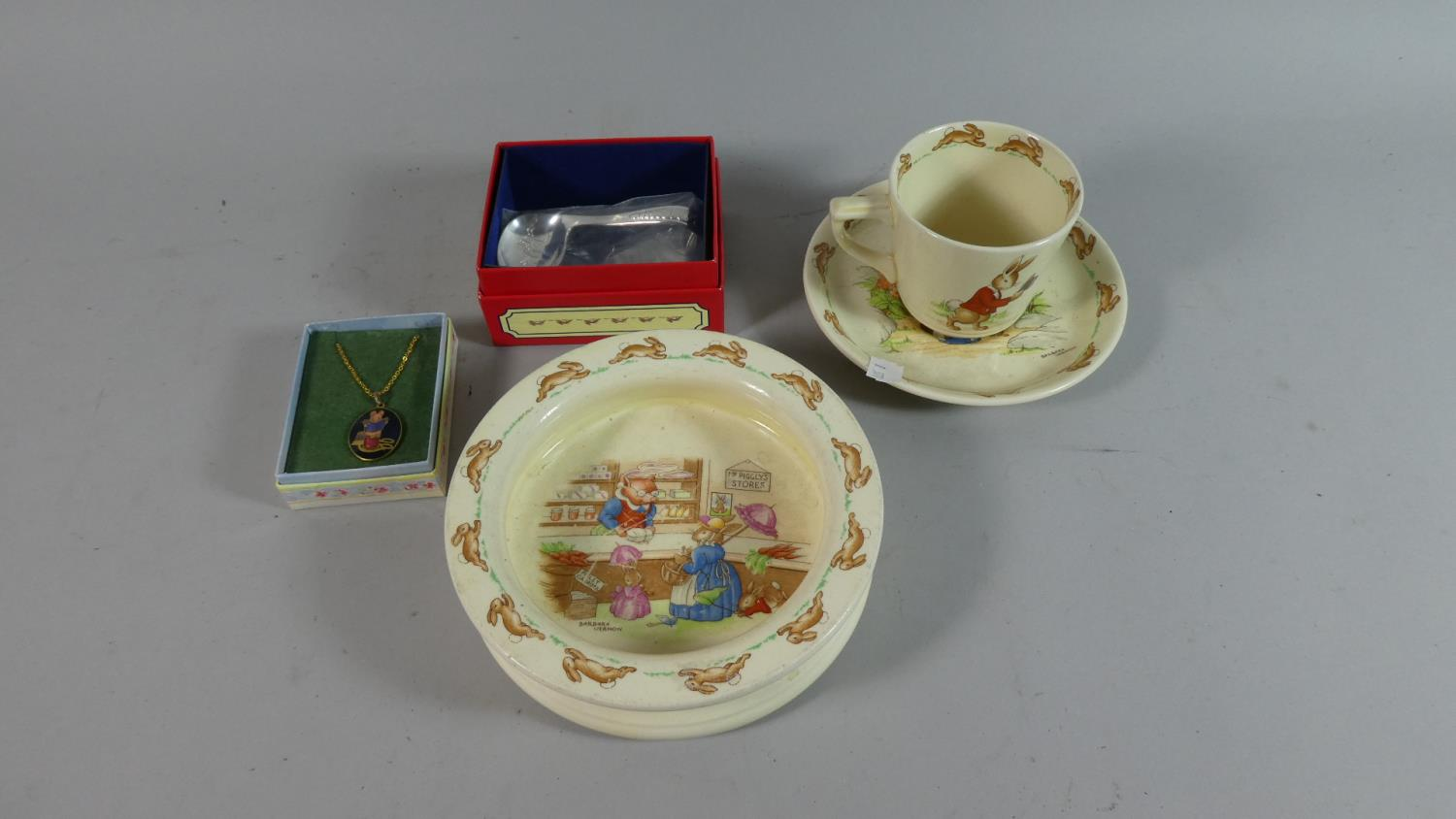 Lot 260 - A Bunnykins Cup, Saucer and Bowl, Boxed Bunnykins Feeding Spoon and Beatrix Potter Pendant
