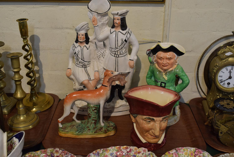 Lot 179 - A Staffordshire Flat Back Robin Hood Spill Vase, Staffordshire Greyhound, Royal Doulton Cardinal and