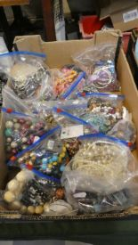 Lot 255 - A Box Containing Fifteen Bags of Costume Jewellery