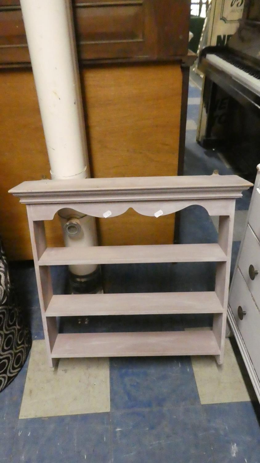 Lot 422 - A Painted Wall Hanging Three Shelf Unit, 66cm Wide