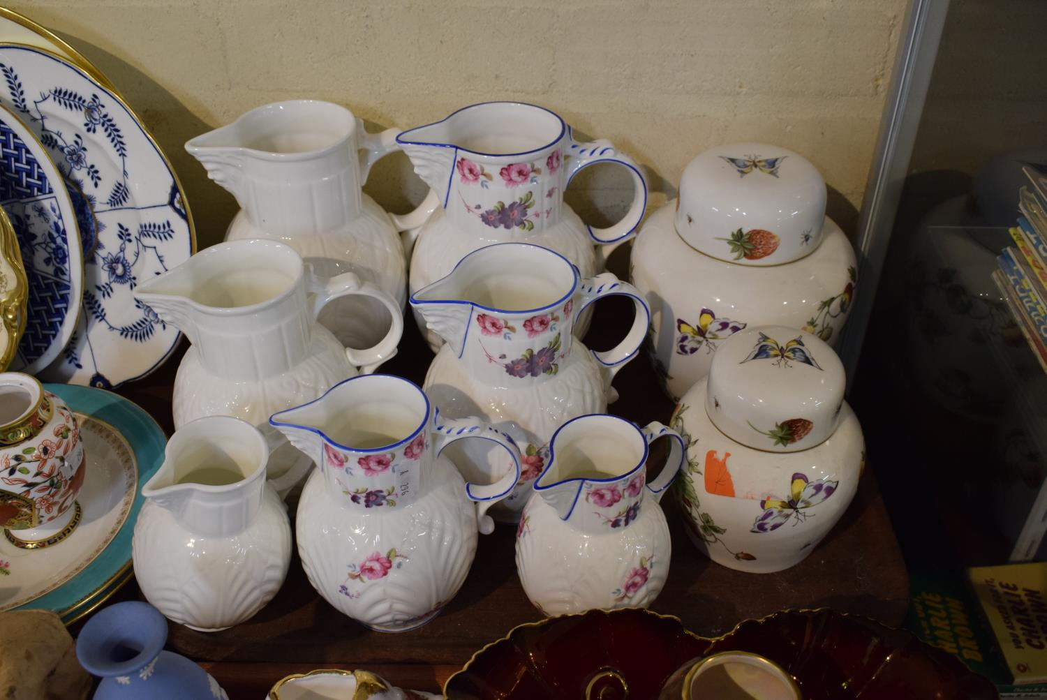 Lot 170 - A Set of Four Graduated Coalport Caughley Mask Head Jugs, a Set of Three Graduated Unmarked Examples