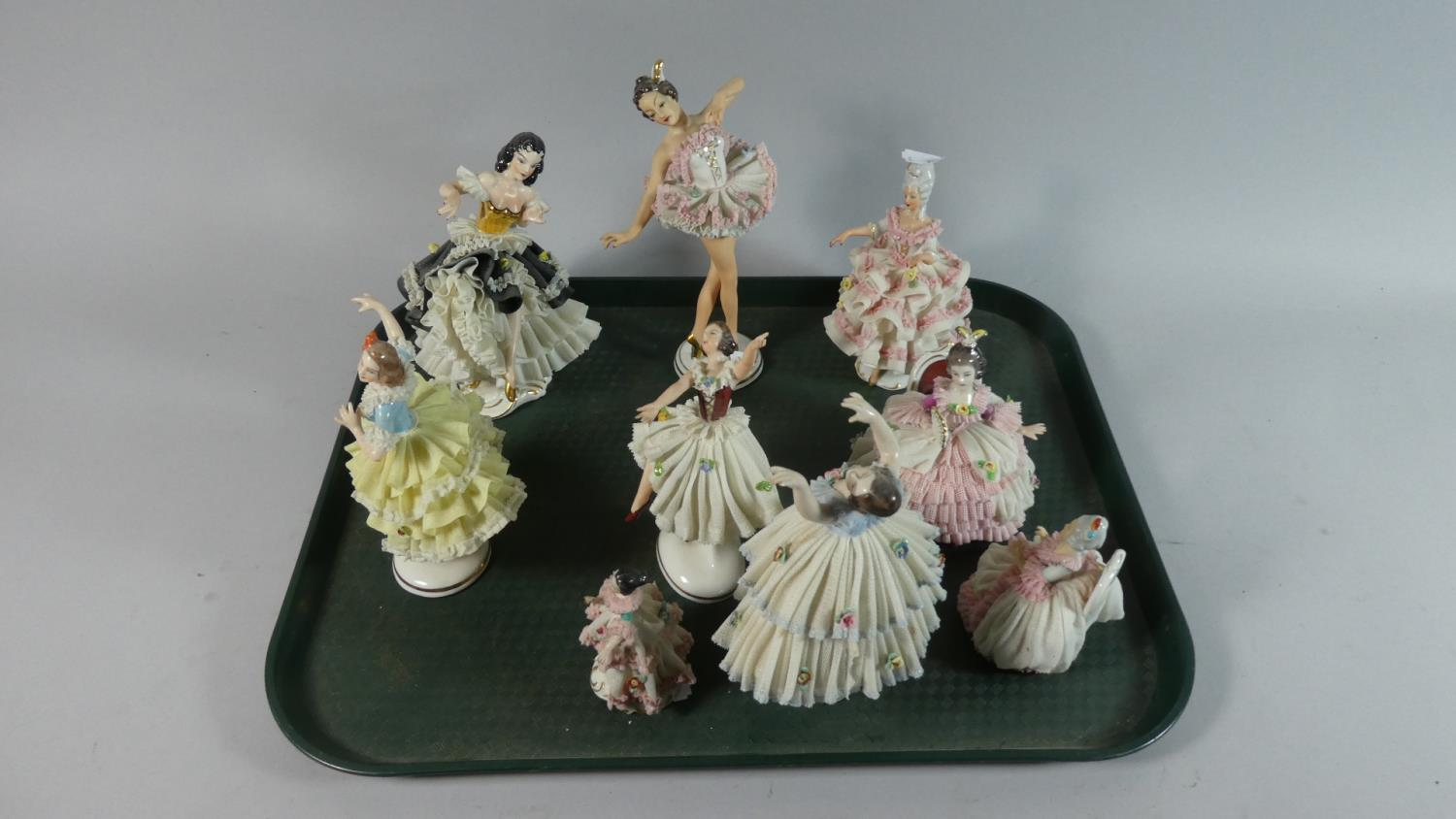 Lot 244 - A Collection of Nine Continental Figural Ornaments of Dancing Girls Including Dresden