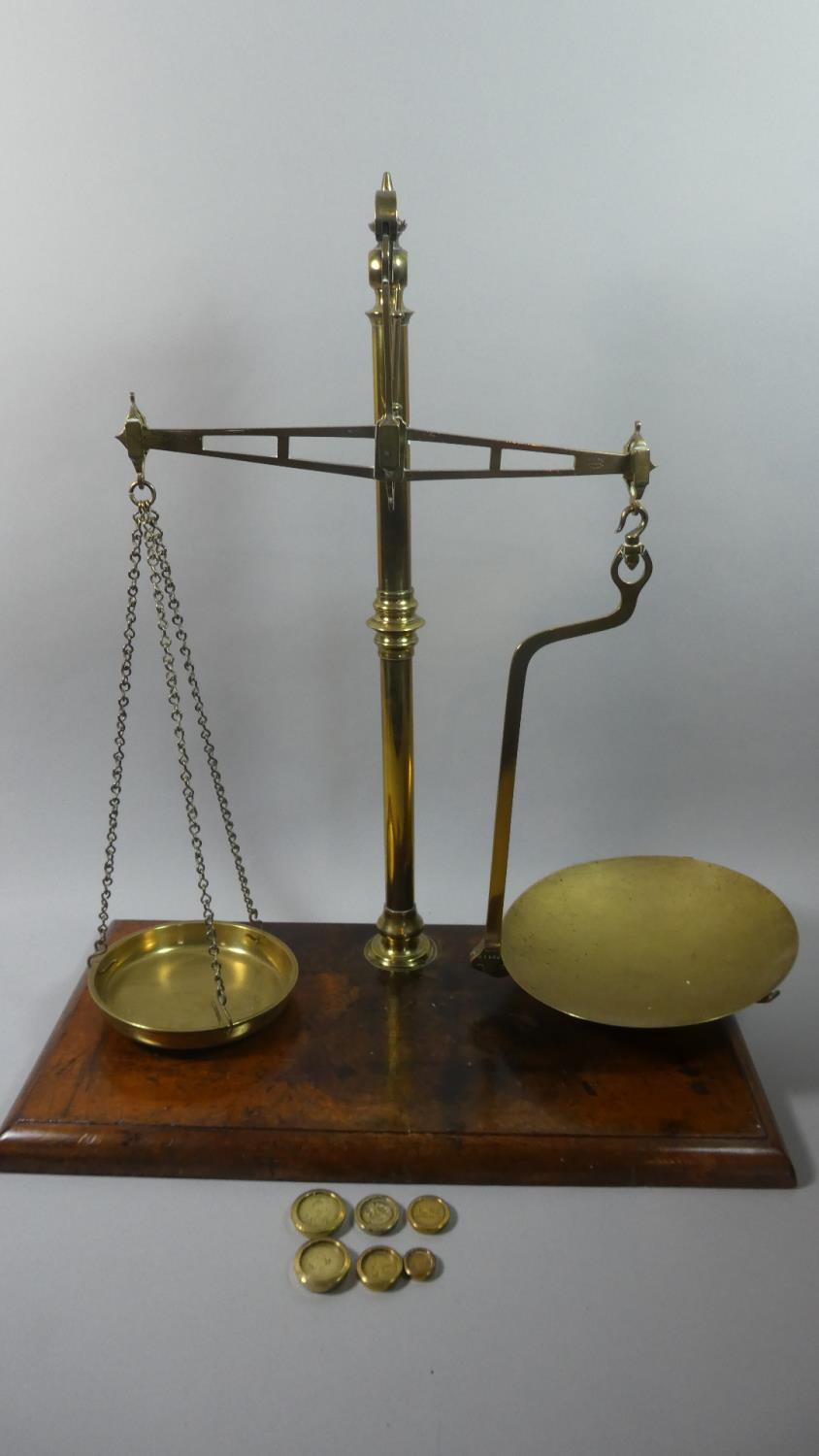 Lot 129 - A Late 19th Century Set of Brass Pan Scales with Weights on Rectangular Wooden Plinth Base, 56cm
