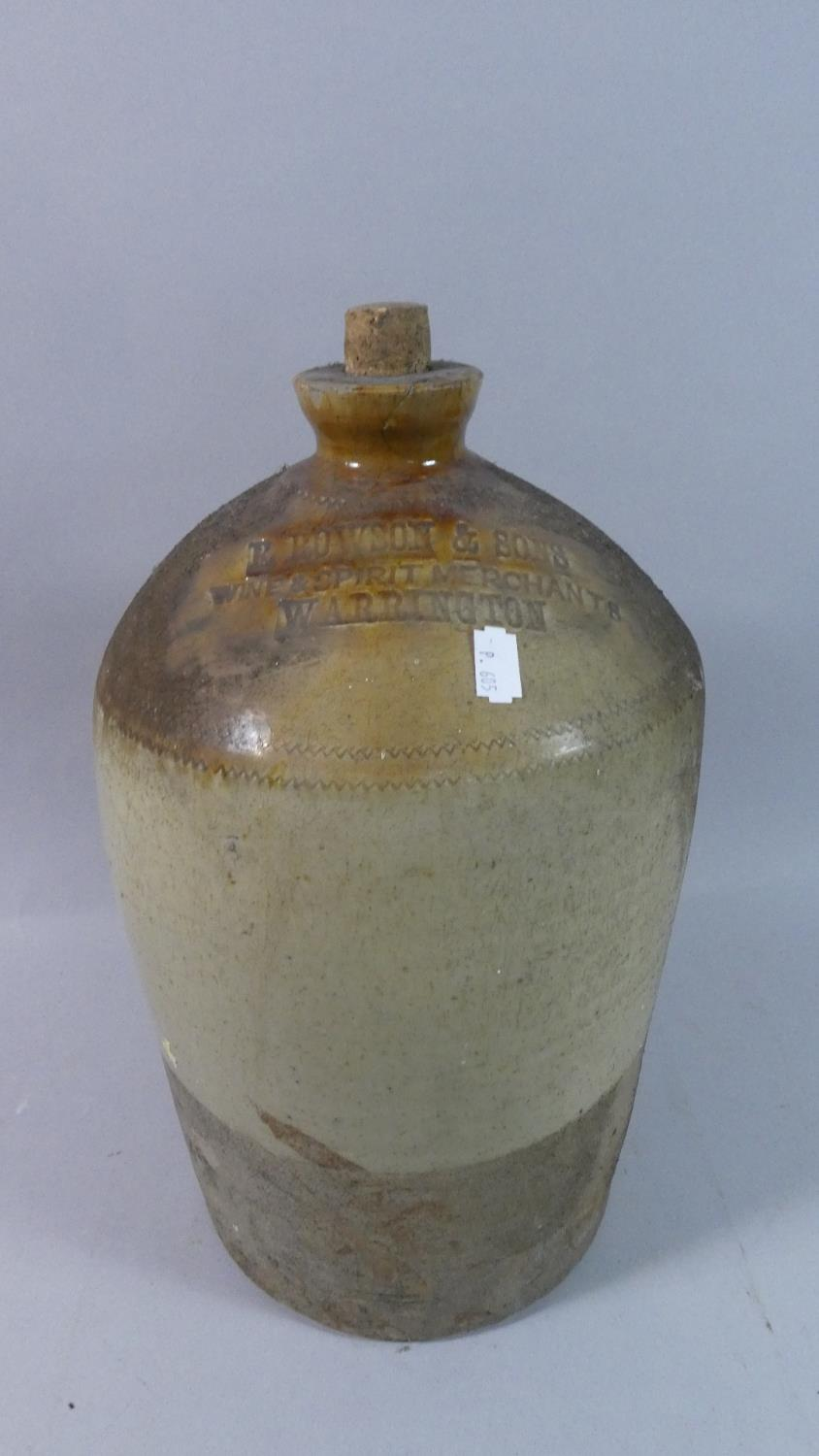 Lot 175 - A Vintage Stoneware Brewers Jar for R Rowson and Sons, Wine and Spirits Merchants Warrington, 39cm