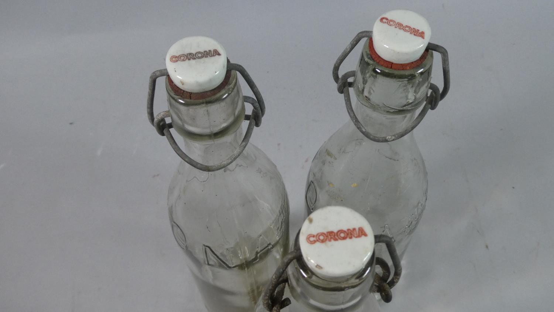 Lot 143 - A Collection of Three Vintage Corona Glass Lemonade Bottles, Each 32cm high