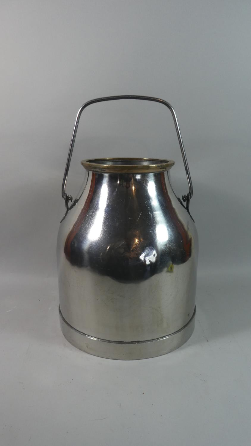 Lot 444 - A Polished Stainless Steel Milk Churn, 37cm High