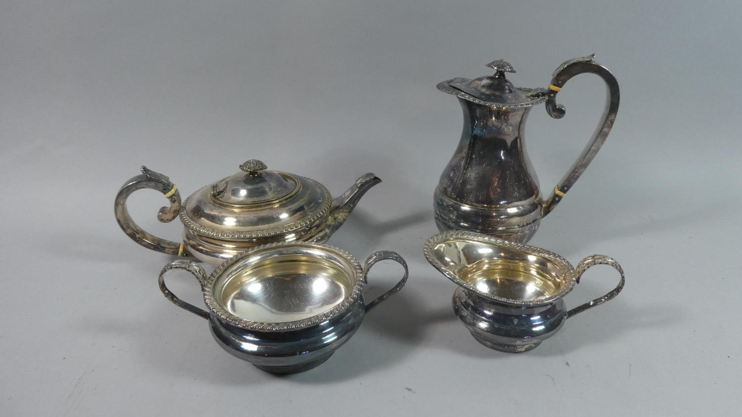 Lot 42 - A Silver Plated Three Piece Teaservice and an Unrelated Hot Water Jug