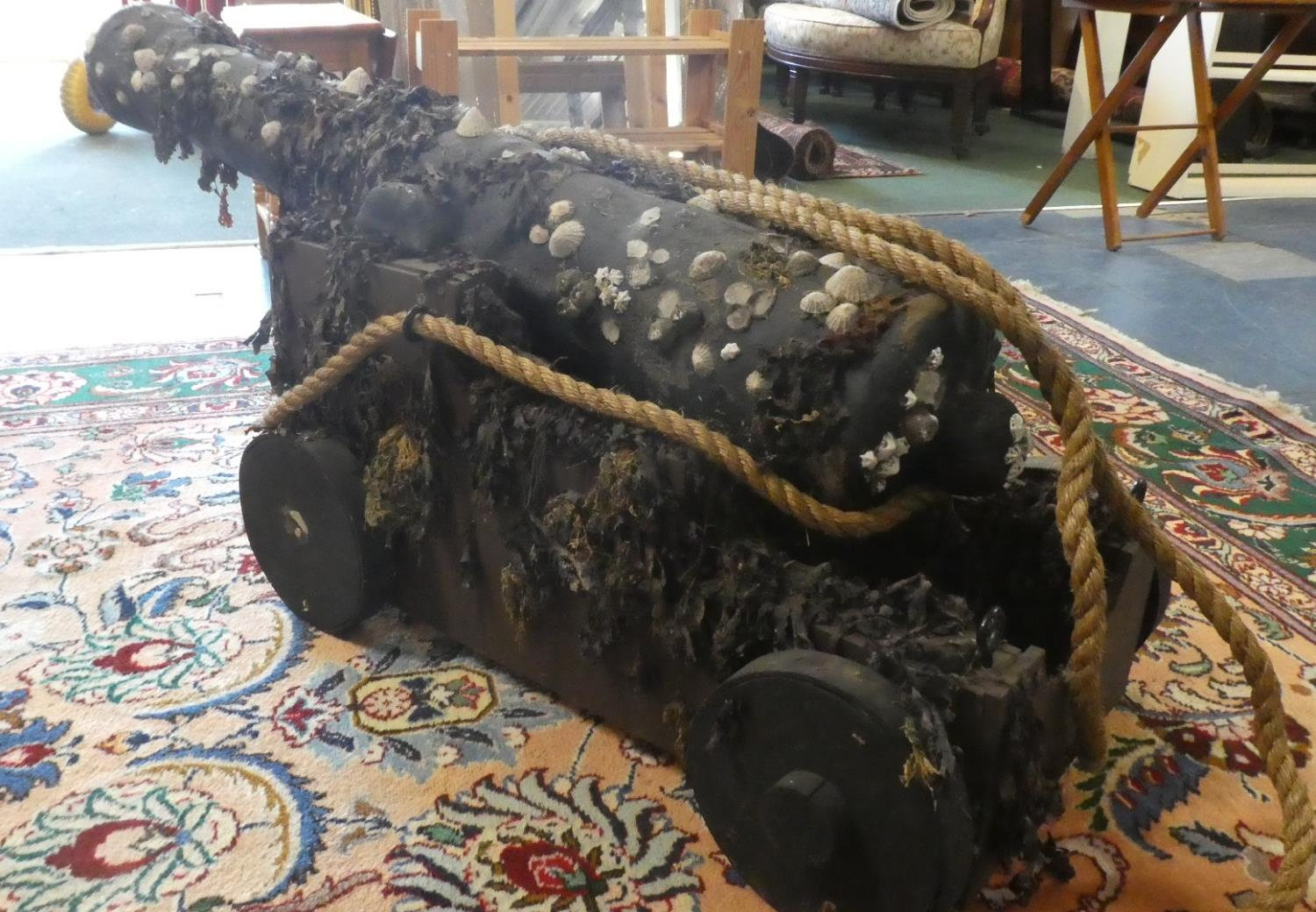 Lot 140 - A Pair of Stage or Film Props in the Form of Ship's Cannons on Carriages with Ropes, Seaweed,