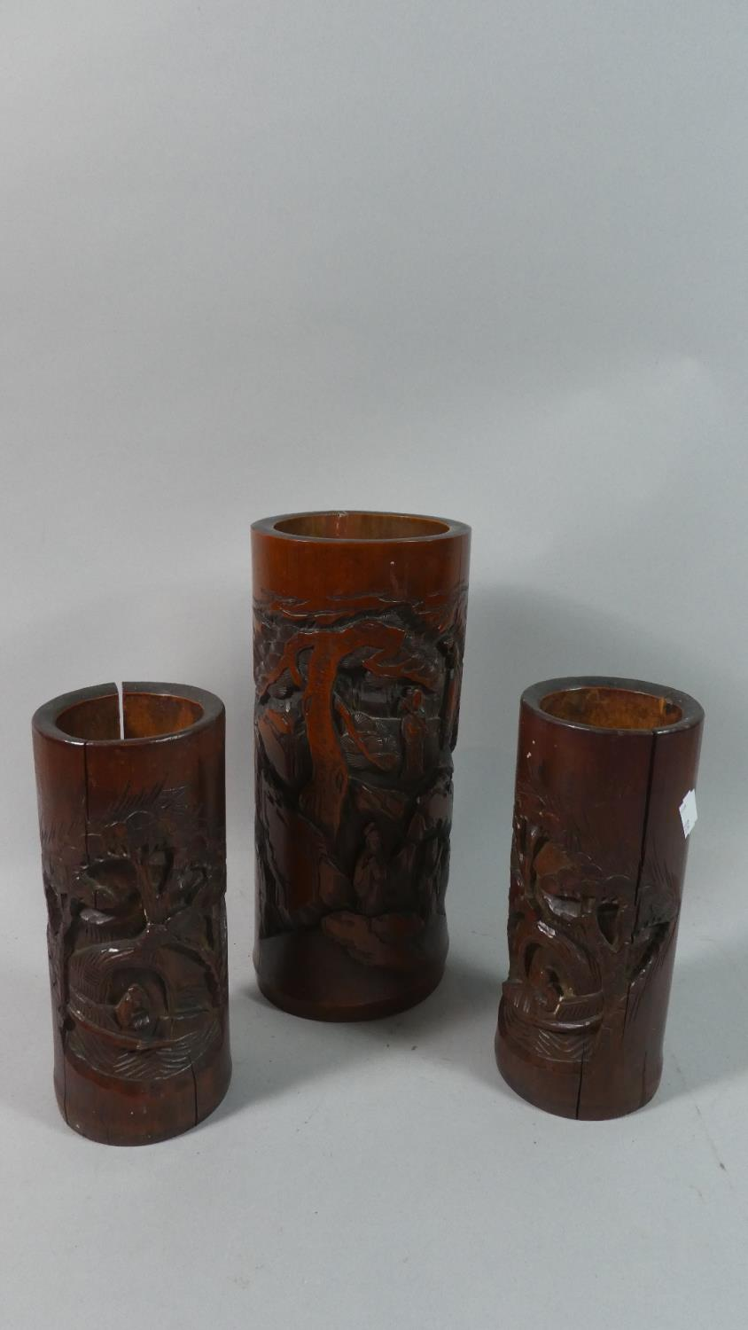 Lot 52 - One Large and Pair of Smaller Carved Oriental Bamboo Brush Pots, 21cm and 28cm High