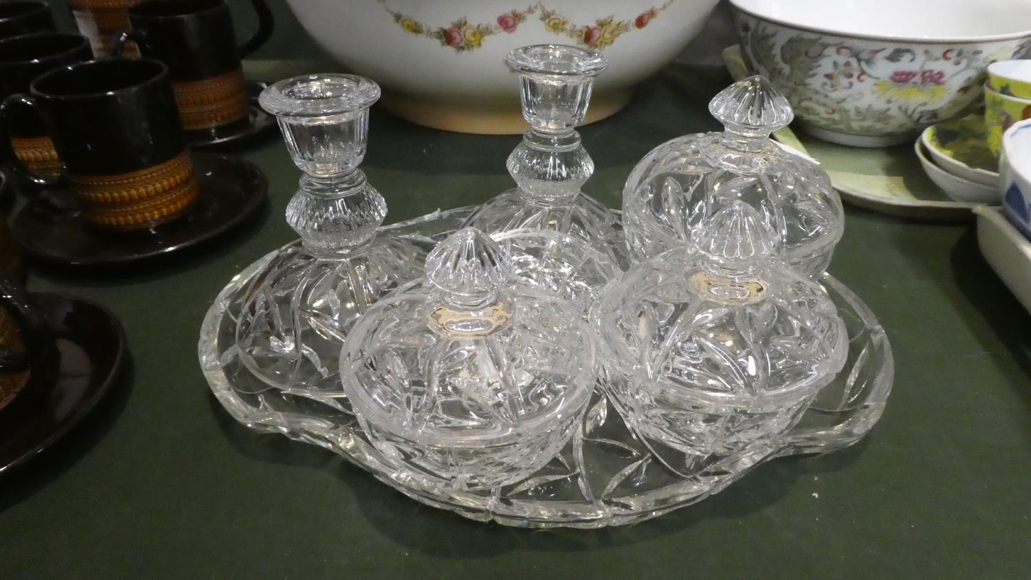 Lot 291 - A Moulded Glass Dressing Table Set