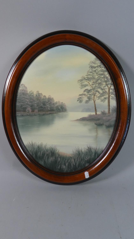 Lot 268 - A Framed Oval Oil on Board Depicting Lake Scene, 48cm High