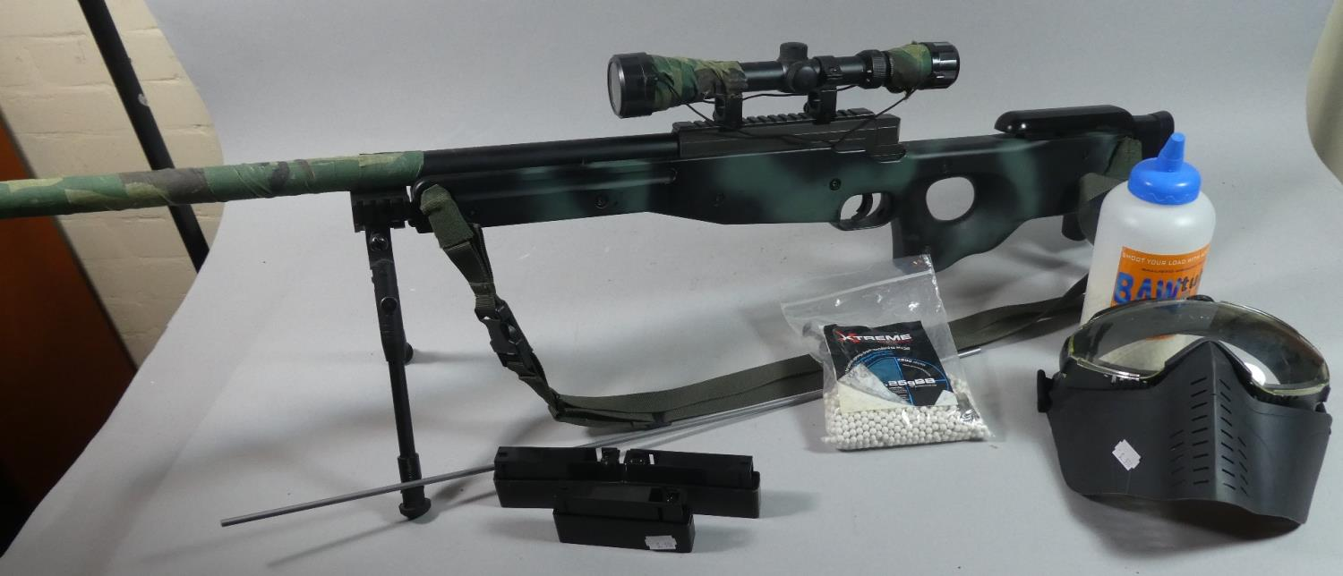 Lot 178 - A Camouflaged Airsoft Rifle with Face Guard, Pellets and Magazines