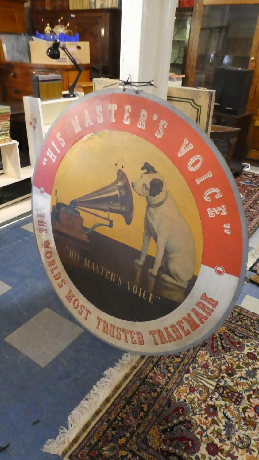 Lot 49 - A Large Mid 20th Century Circular Sign on Cardboard, His Master's Voice-The Worlds Most Trusted