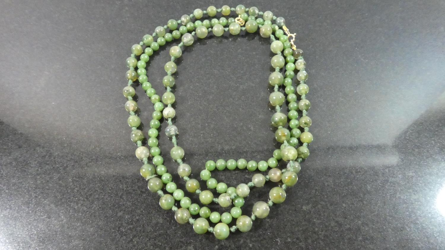 Lot 409 - A Moss Agate Necklace with 9ct Gold Clasp and a Jade Bead Necklace