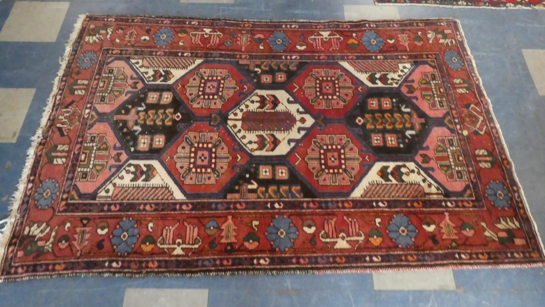Lot 409 - A Persian Hand Made Bakhtiari Rug. 220x120cms