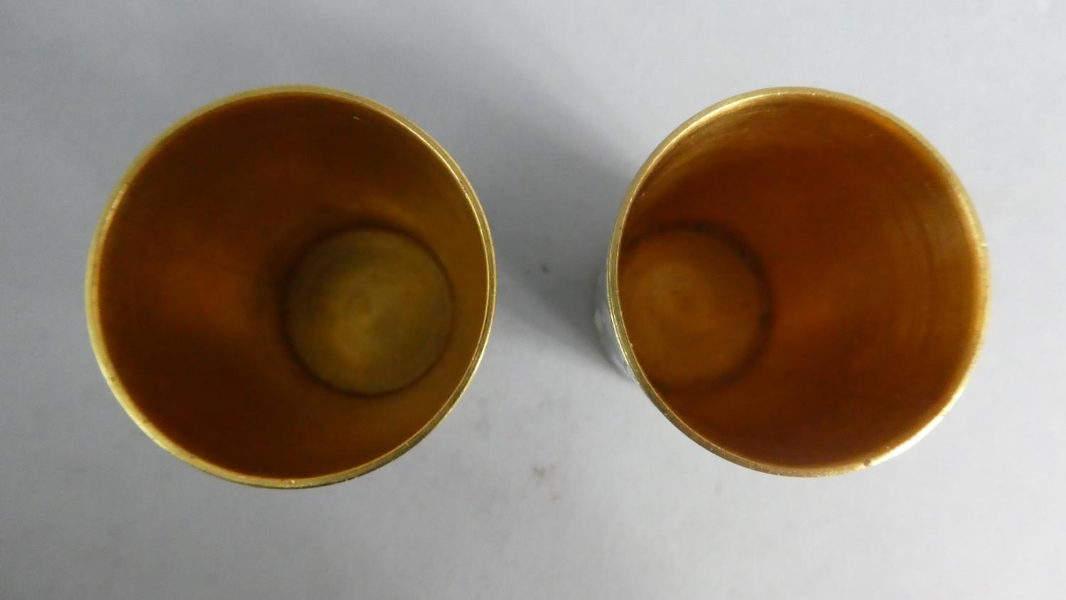 Lot 230 - A Pair of Gilt Metal and Enamel Russian Tots, Stamped to Base Woiv, 4cms High