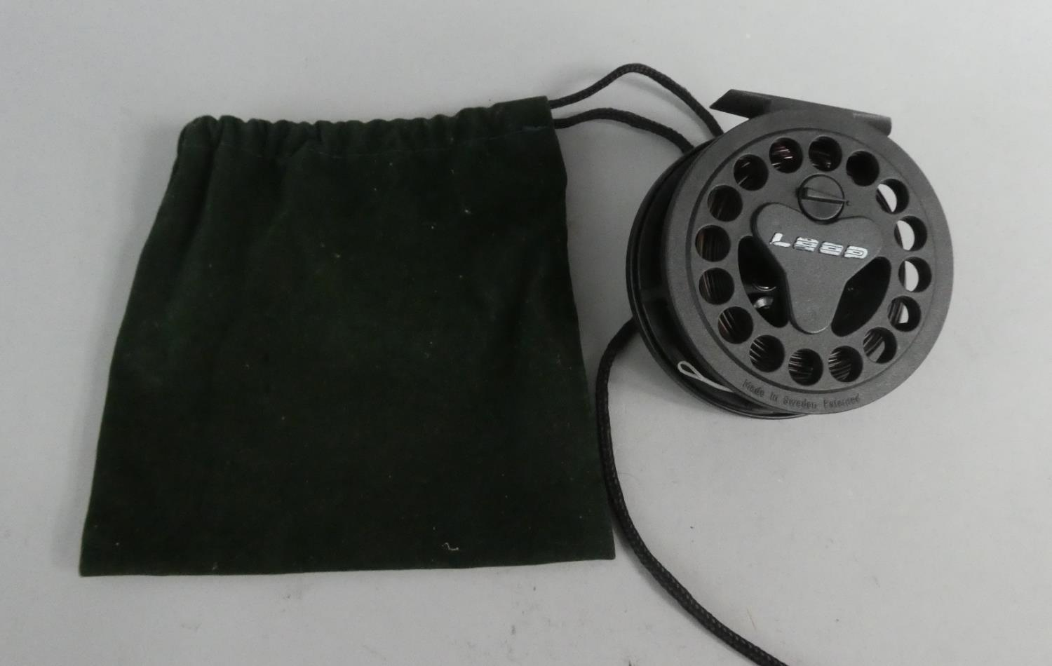 Lot 108 - A Loop Graphite Fishing Reel, Sinking Line and Green Velvet Carry Bag