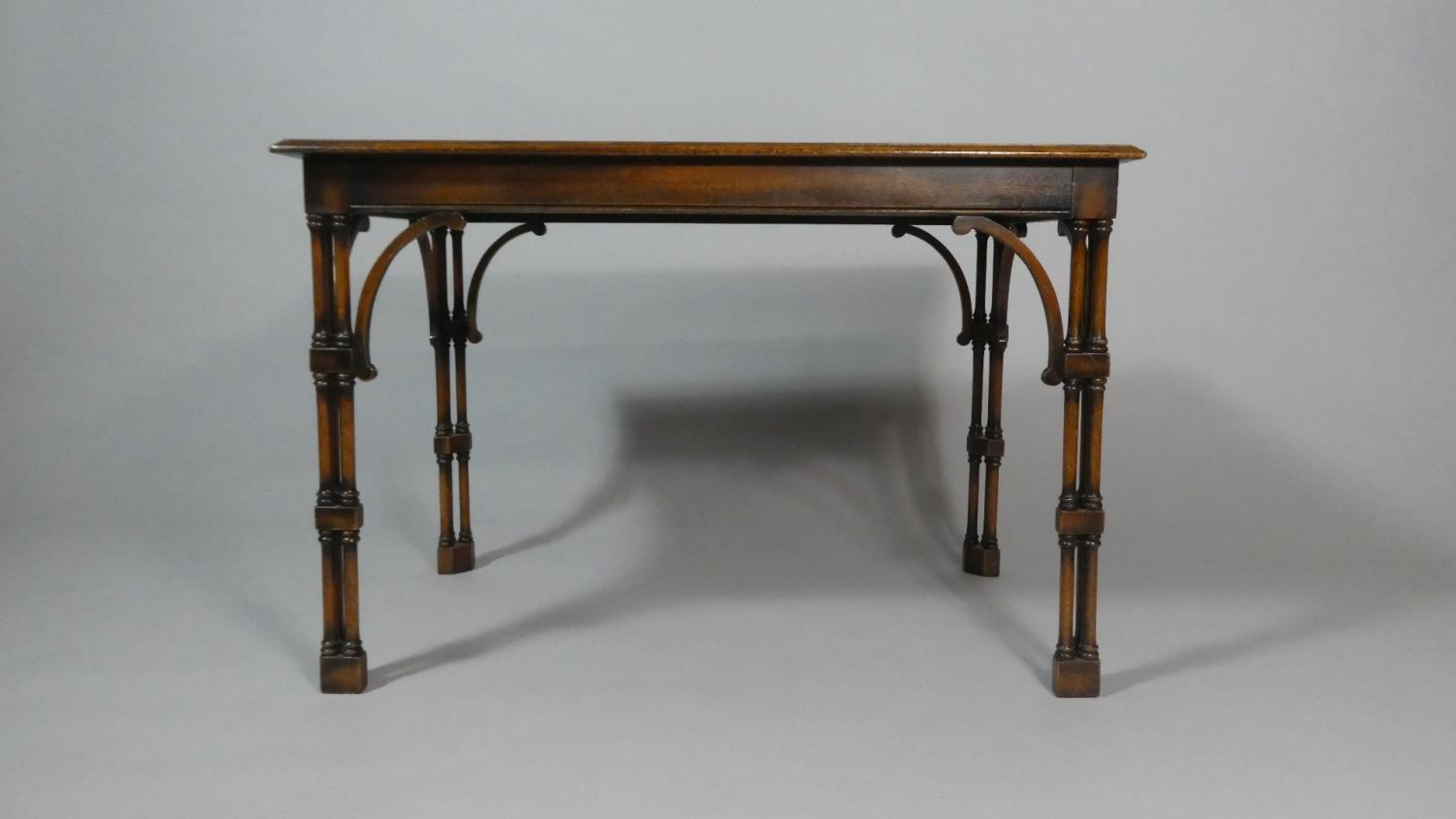Lot 11 - A Reproduction Mahogany Occasional Table with Unusual Tri-Spindle Supports