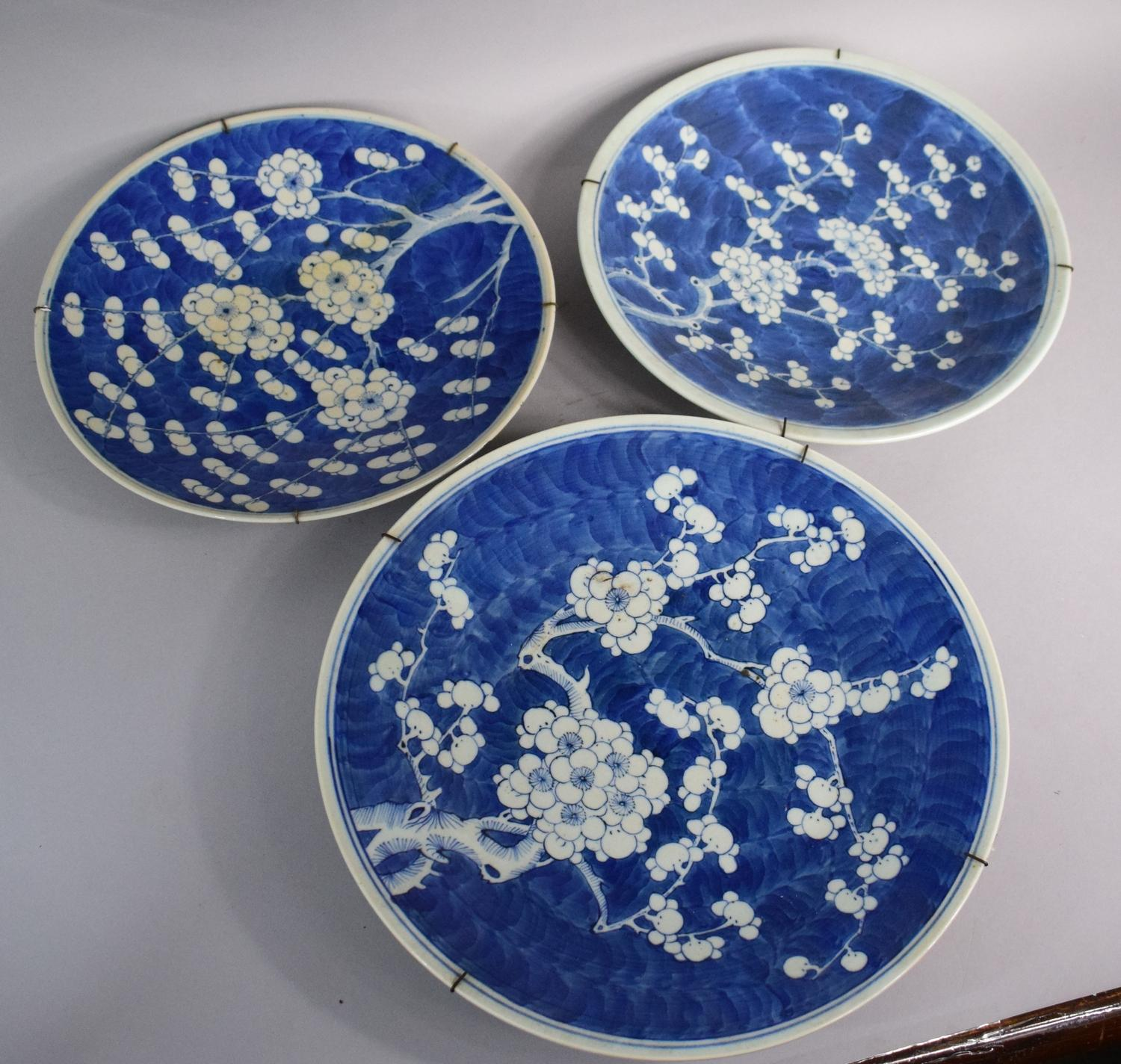 Lot 411 - A Collection of Three Chinese Blue and White Glazed Stoneware Chargers with Prunus Pattern. 35cms,