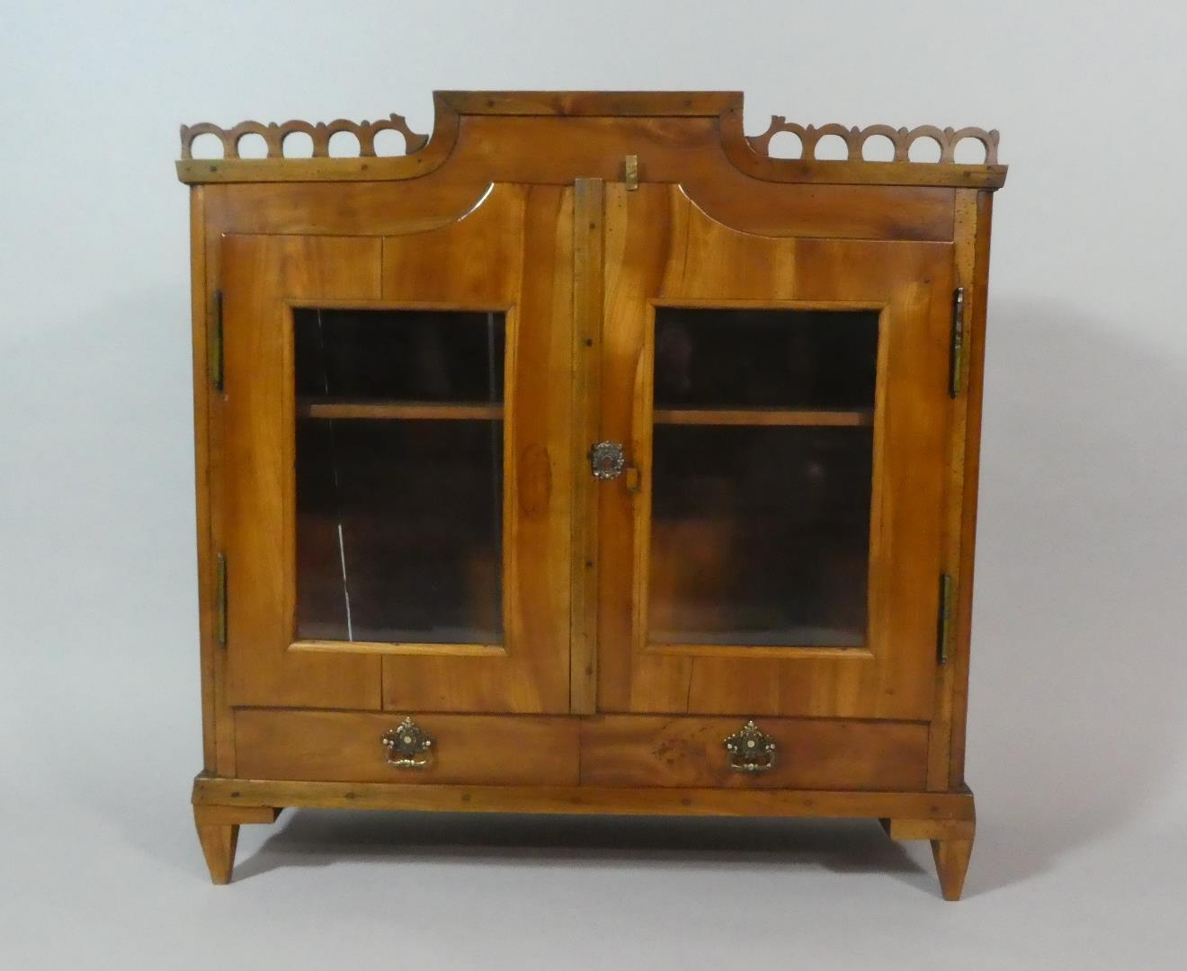 Lot 50 - A 19th Century French Cherrywood Table Top Bookcase, with a Pierced Frieze Over Two Glazed Doors and