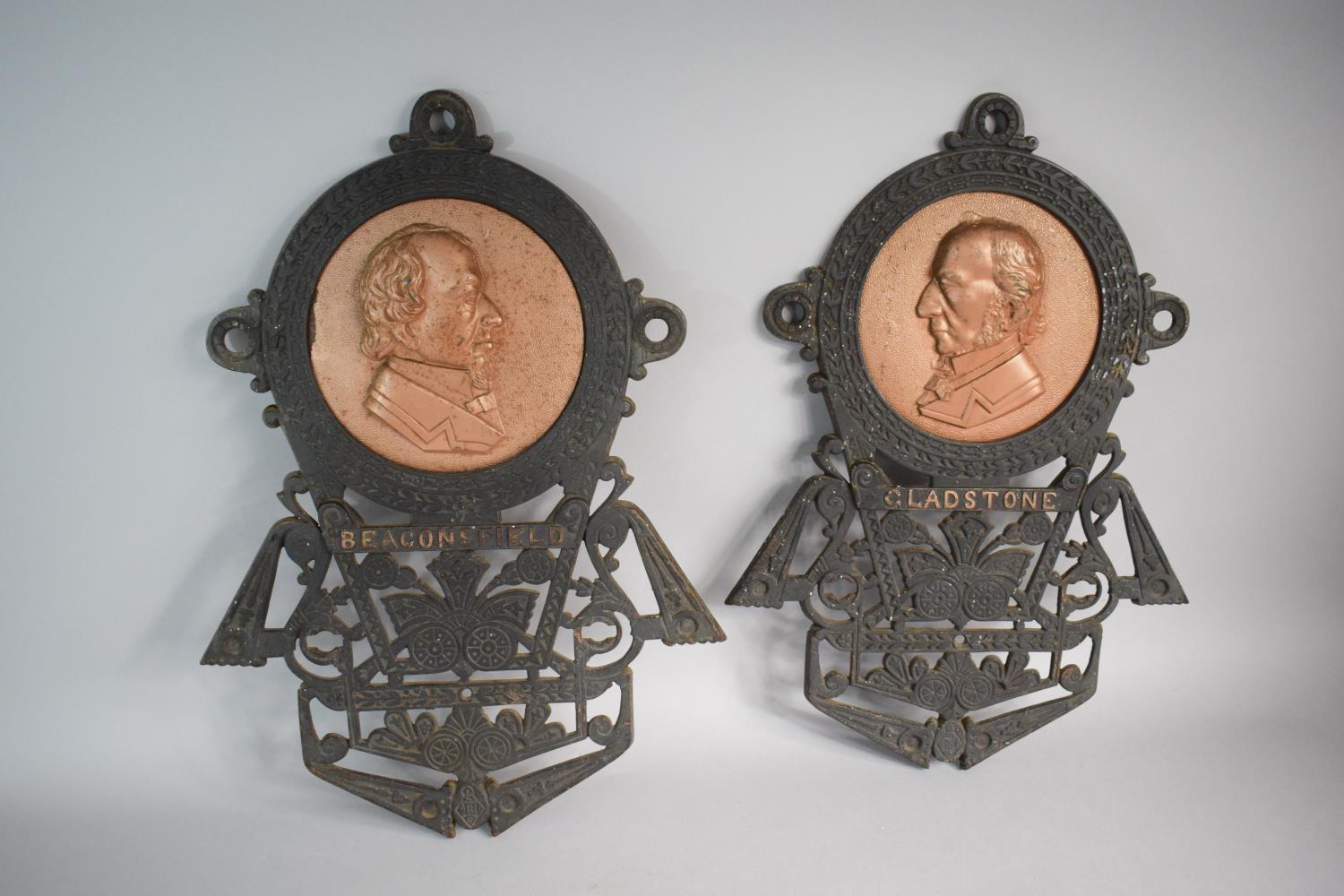 """Lot 89 - A Pair of Cast Iron Plaques in Pierced Cast Iron Surrounds, """"Gladstone"""" and """"Beaconsfield"""" Each 48."""