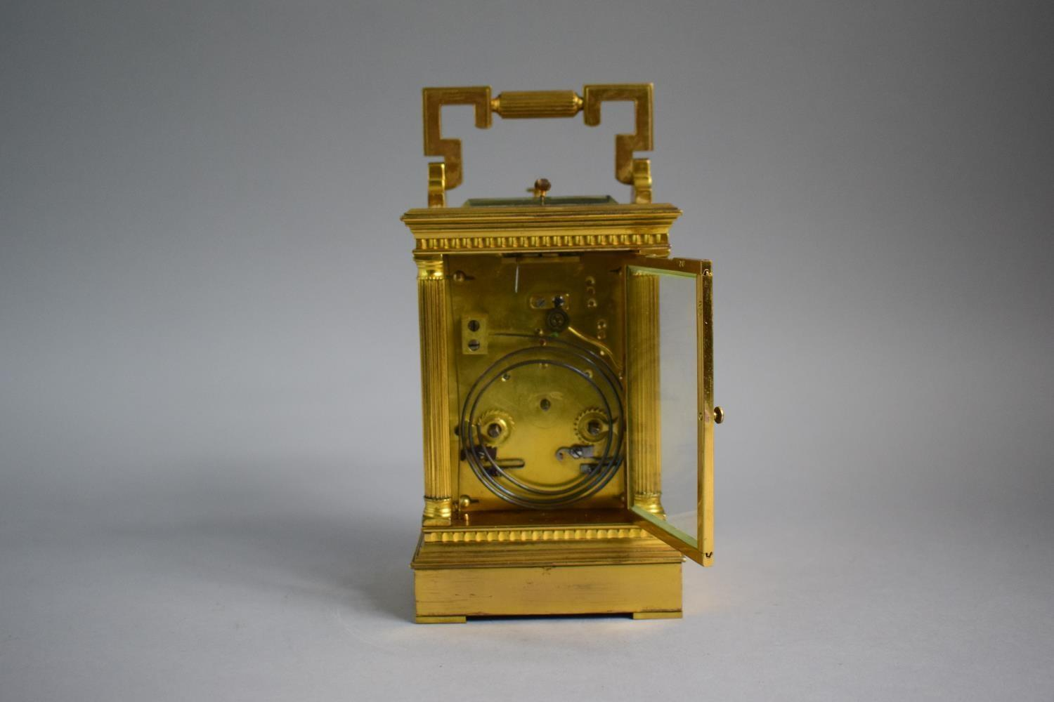 Lot 346 - A French Late 19th Century Gilt Brass Cased Musical Carriage Clock with Repeater Movement. Reeded