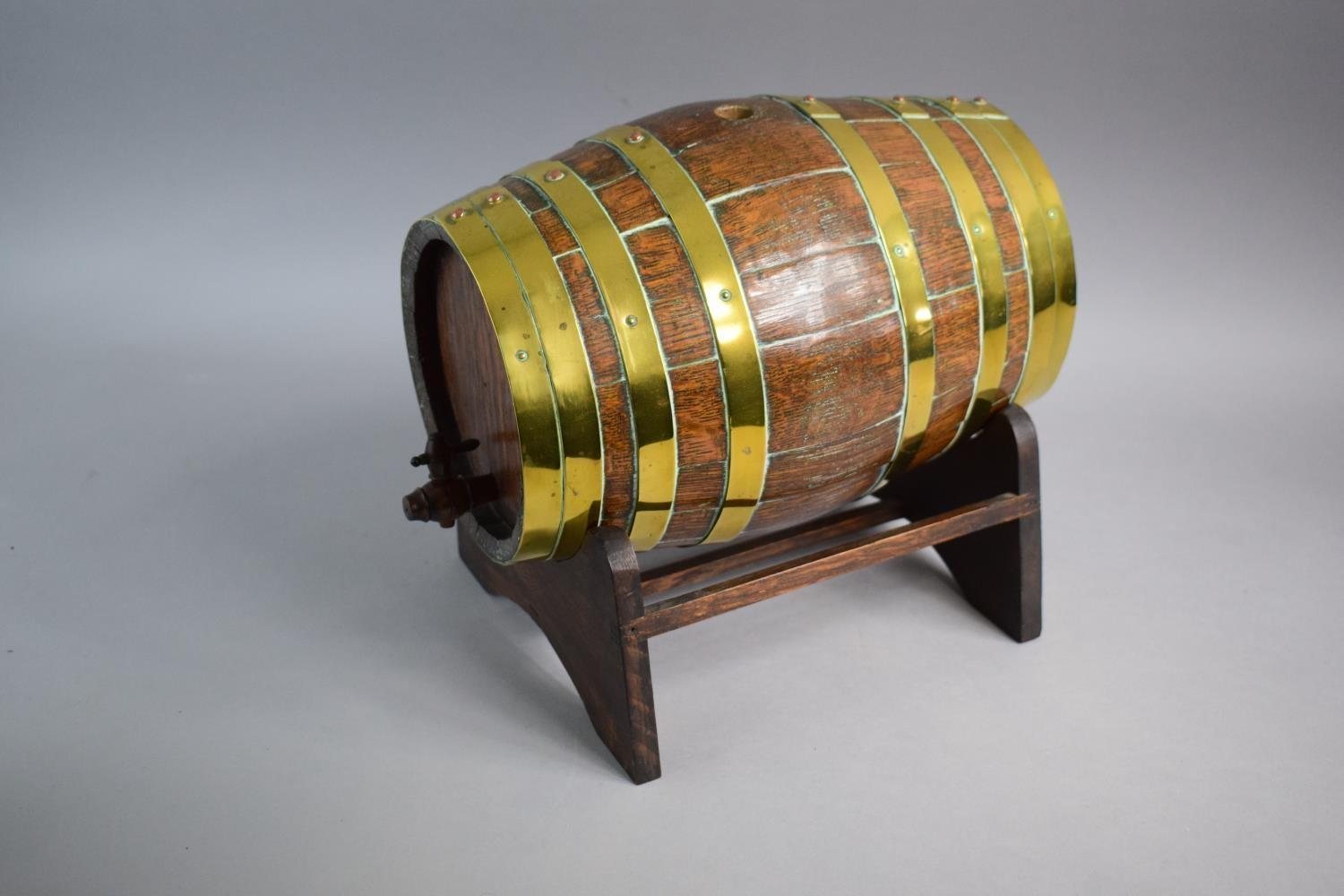 Lot 2 - A Late 19th Century Brass Banded Oak Spirit Barrel on Stand. 28.5cms Long. Complete with Tap