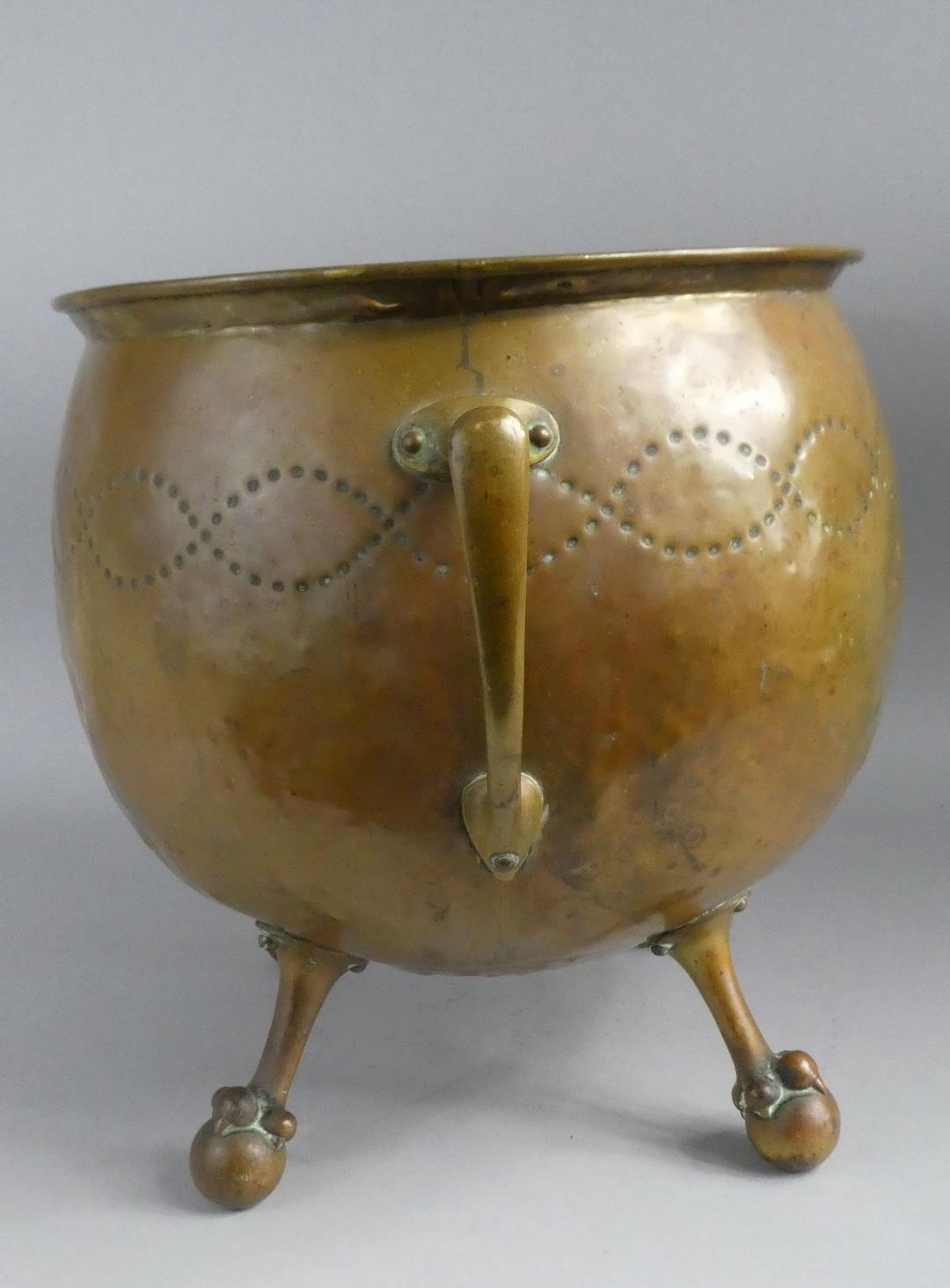 Lot 13 - An Arts and Crafts Beaten Brass Globular Coal Bucket/Jardiniere with Stylised Handles and on Four