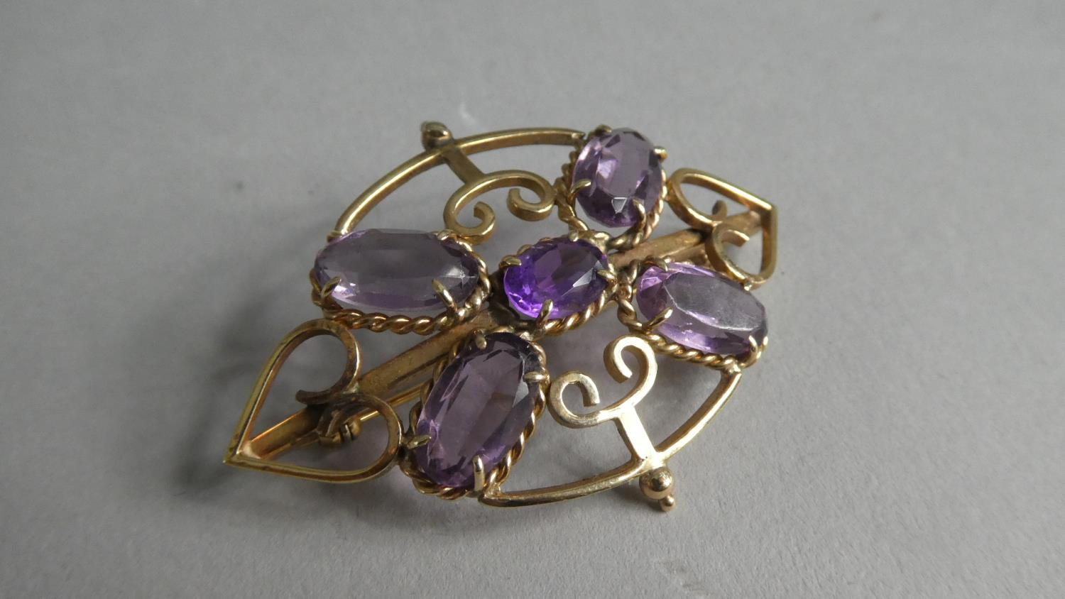 Lot 258 - A Pretty Early 20th Century Amethyst and 9ct Rose Gold Brooch Stamped to Reverse KXP or KMJ. 5cms