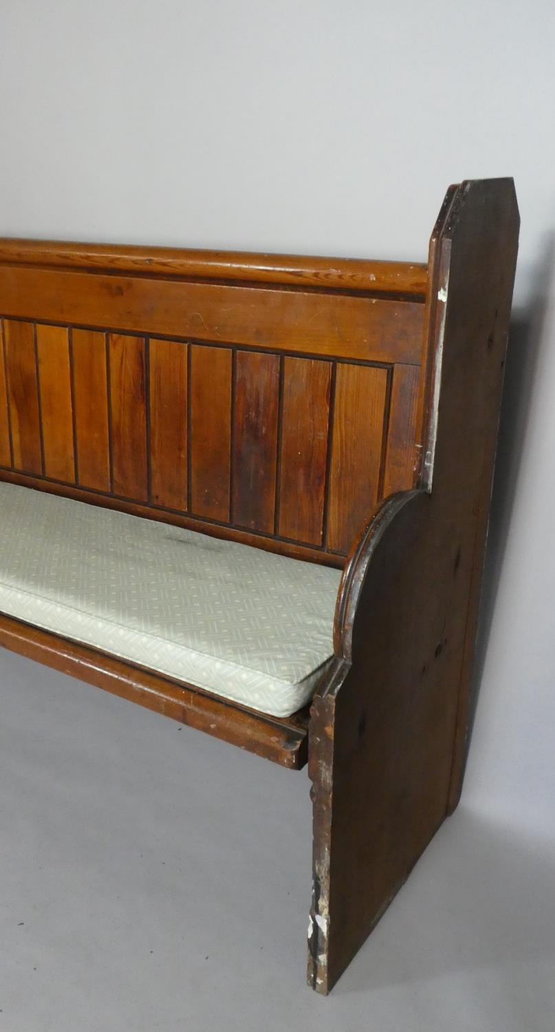 Lot 453 - A Late Victorian Pitch Pine Pew with Foam Cushion Pad. 203cms Long