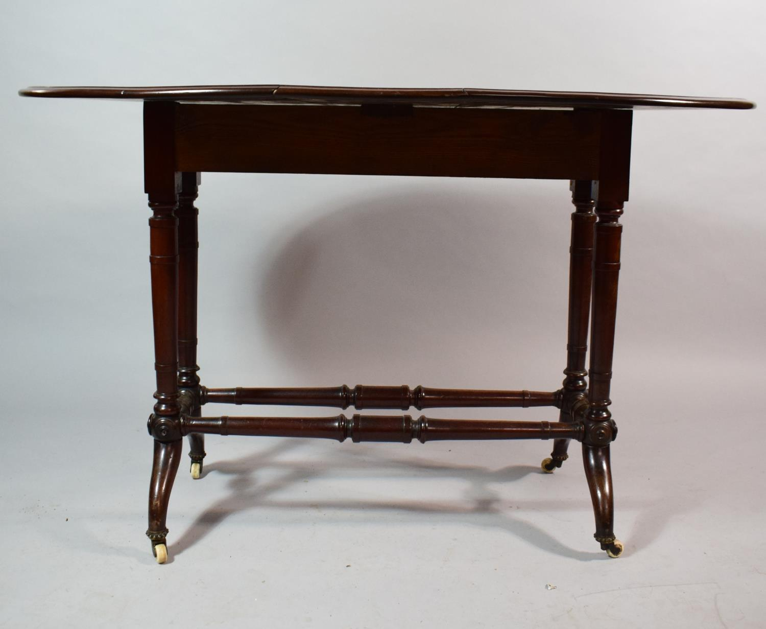 Lot 463 - A Late 19th Century Mahogany Drop Leaf Sutherland Table on Turned Supports and Stretcher. Lift and