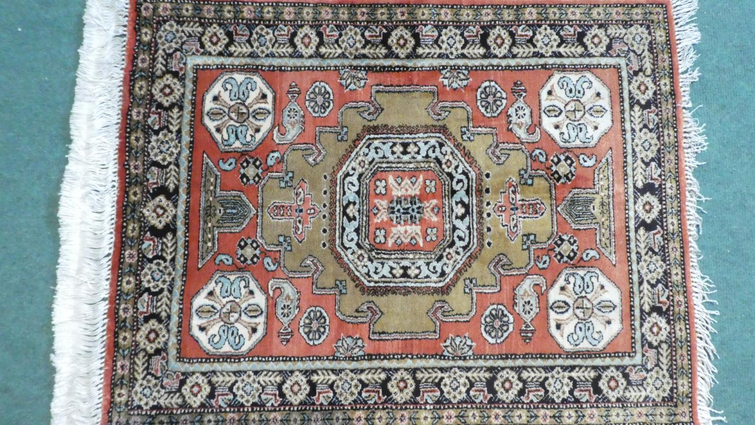 Lot 179 - A Persian Hand Made Silk Qum Rug. 74x58