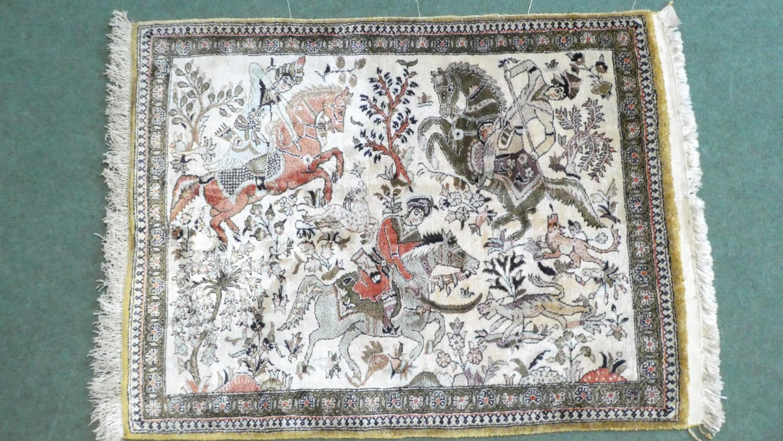 Lot 181 - A Persian Hand Made Silk Qum Rug. 81x63cms